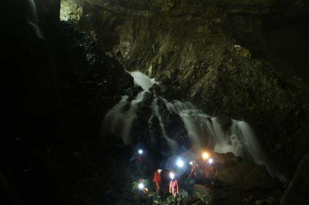 Descent to the foot of the waterfall -La Verna cave, Aquitaine, France